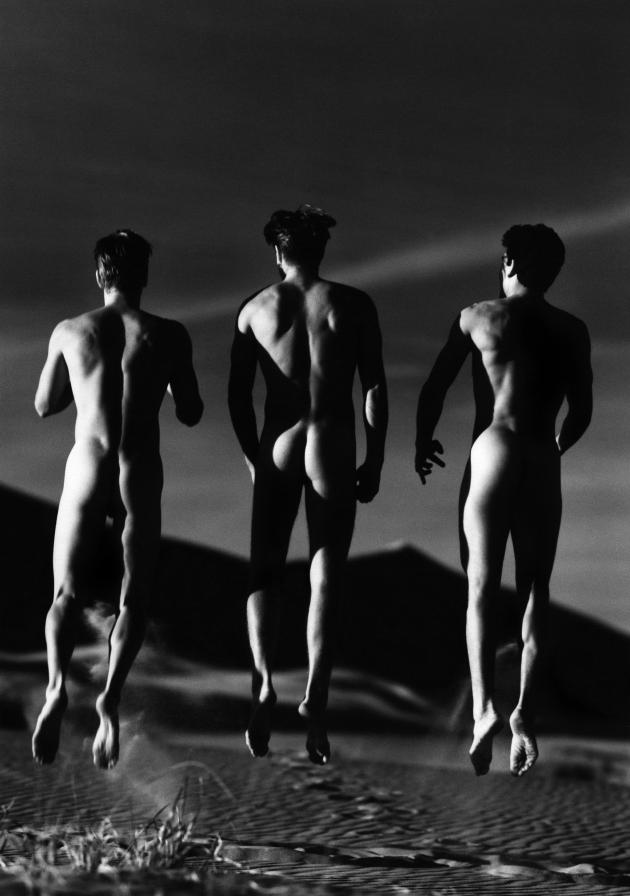 Three Boys Jumping, Kelso Dunes, 1991. © Gre