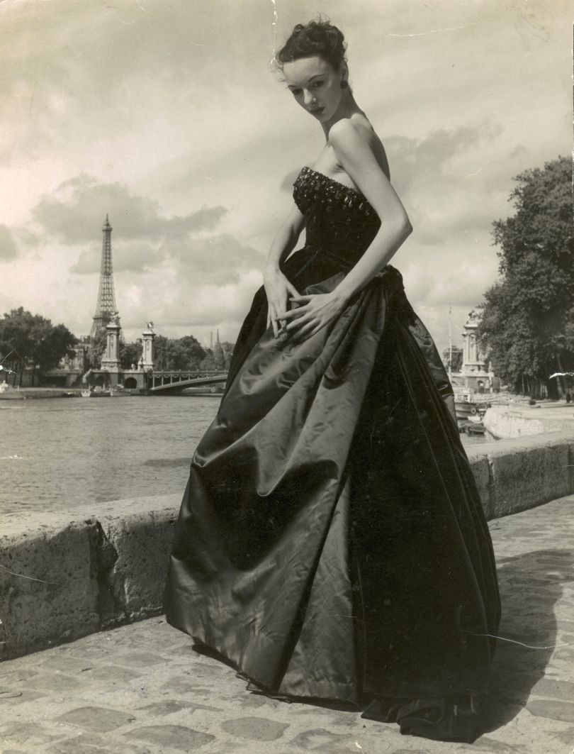 June modelling a dark green velvet and silk satin evening dress by Christian Dior Paris 1951 photograph by Hans Wild featured on the cover of Vanity Fair magazine Nov 1951
