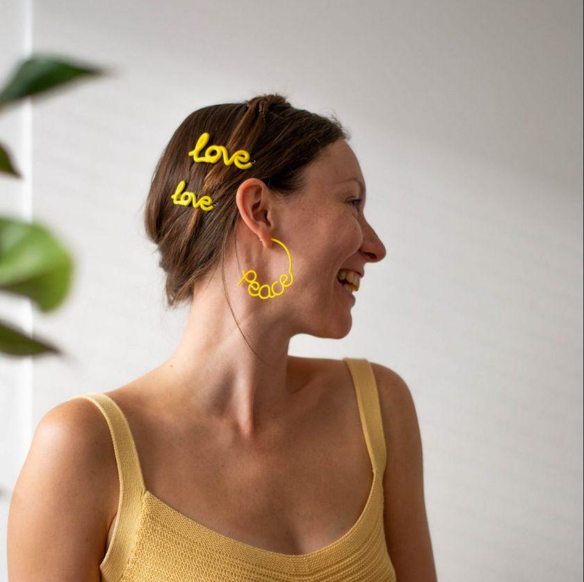 'Peace' earrings £75, 'Love' Hair Clip from £32 by [Zoe Sherwood](https://www.zoesherwood.co.uk/product/love-hair-clip/)
