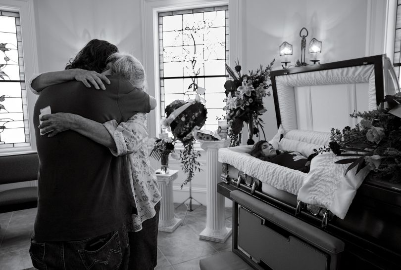 Cheryl Schmidtchen, 67, being consoled at the funeral for her granddaughter Michaela Gingras in Manchester, N.H., on September 17th, 2017. Gingras, a heroin user, was 24. Photograph by James Nachtwey for TIME