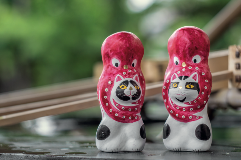 The most popular of Ryuma Sagara's folk toys depicts an octopus wrapped around a cat. They are so beloved for their design that demand for these cats supersedes production output. Fans buy them all year round and there is no off-season. © Jerfareza Daviano