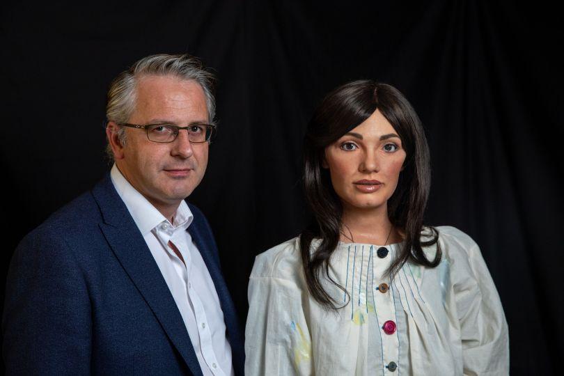 Ai-Da with her maker, Aidan Meller. Photography by Victor Frankowski