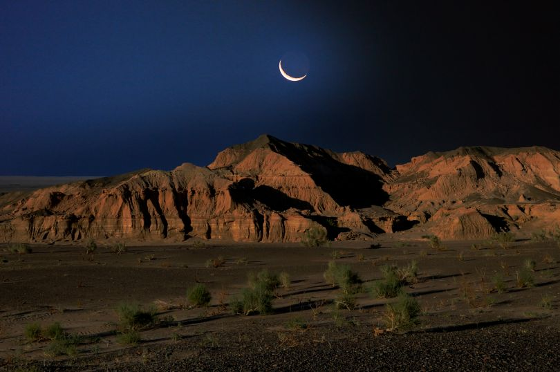Midnight Blue Moon on Flaming Cliffs, Mongolia, 2016 © Marc Progin. Courtesy of Blue Lotus Gallery