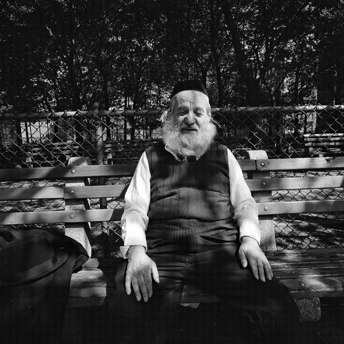 White Bearded Man on Park Bench in Dappled Sunlight, NY, May 1977 © Meryl Meisler
