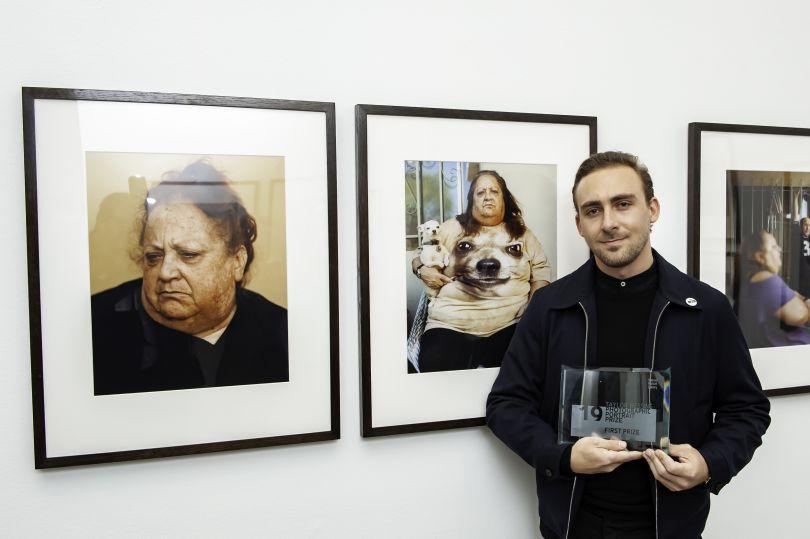 Pat Martin with his winning portraits. Photograph by Jorge Herrera