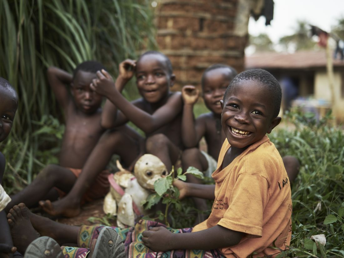 Joe Smart, 6, known as 'Strong Joe', plays with his friends, outside his home in the village of Tombohuaun, Kailahun District, Sierra Leone, May 2017. WaterAid/ Joey Lawrence
