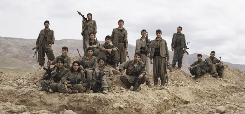 PKK guerrillas pose near their trench position outside Makhmur Refugee Camp. Makhmur, Erbil Governorate, Iraq, March 4, 2015. From [We Came From Fire](https://amzn.to/2L9l8Vm) by Joey L. – published by powerHouse Books