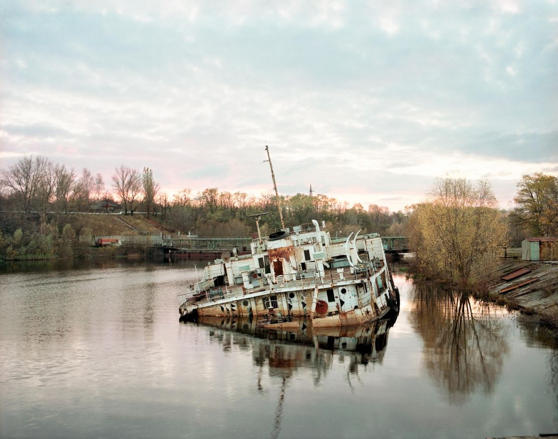 Sinking boat on the Pripyat river, Chernobyl, October 1998. From the book, David McMillan: Growth and Decay - Pripyat and the Chernobyl Exclusion Zone, published by [Steidl Books](https://steidl.de/Books/Growth-and-Decay-Pripyat-and-the-Chernobyl-Exclusion-Zone-2326353746.html?SID=wNv9pBXee1bc) © David McMillan, 2018