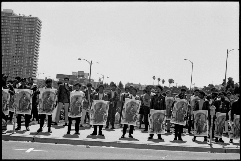"""Black Panthers with posters of Black Panther Party Minister of Defense, Huey P. Newton rally outside the Alameda County Courthouse, Oakland CA, during Newton's trial September 1968. From, """"The Lost Negatives,"""" photographs by Jeffrey Henson Scales. Credit: Jeffrey Henson Scales"""