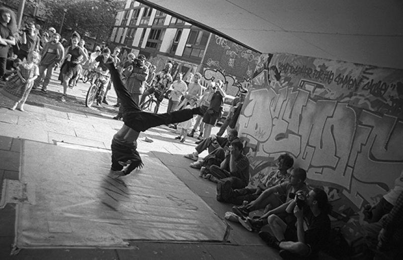 B.boy Evo dancing at the Smear II event, Hulme 1996 - Photograph by Al Baker