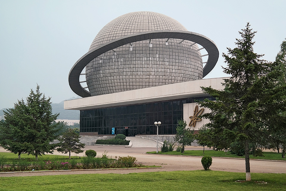 "The planetarium forms part of the Three Revolutions Exhibition park, a grand expo campus built in 1992 to showcase the ideological, technological and cultural achievements of North Korea, from heavy industry and mining to agriculture and electronics. The Three Revolutions movement started in 1973, when Party activists went around the country campaigning ""to raise the ideological level of the people, equip the economy with modern techniques and to lift the people's technological and cultural level."" Copyright: © Oliver Wainwright"