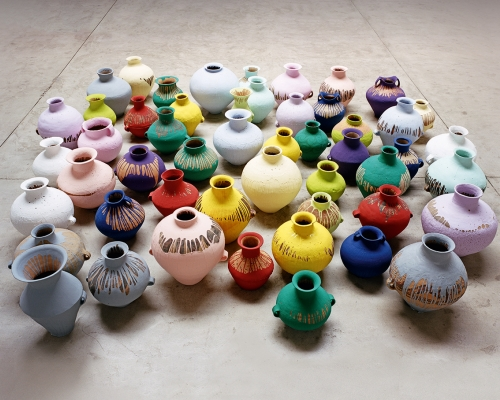 Ai Weiwei, Coloured Vases, 2006, 51 Neolithic vases, (5,000–3,000 BCE), industrial paint, variable dimensons. Picture credit: Courtesy of Ai Weiwei Studio