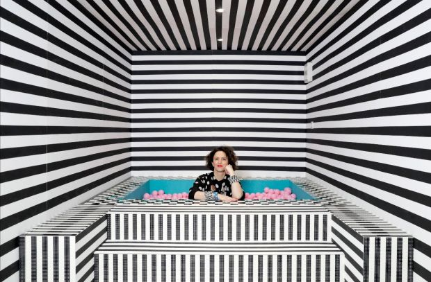 Camille Walala in the ballpit of her HOUSE OF DOTS installation for LEGO. Photo credit Getty Images.