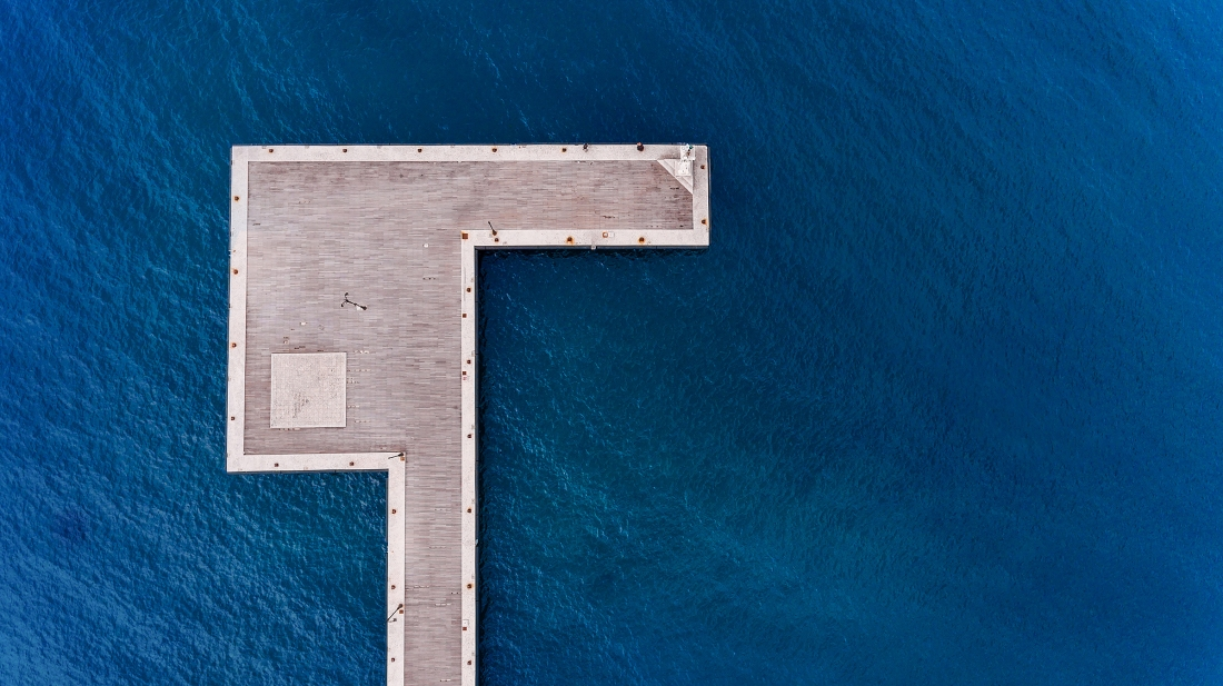 An aerial shot of a dock in Kos island of Greece. The unique shape of the dock from above make me put it, in 1/3 of an aerial frame. The blue sea and the light wood boards makes a very nice and minimal contrast. Copyright: © Emmanouil Smalios, Greece, Shortlist, Open, Architecture (Open competition), 2018 Sony World Photography Awards