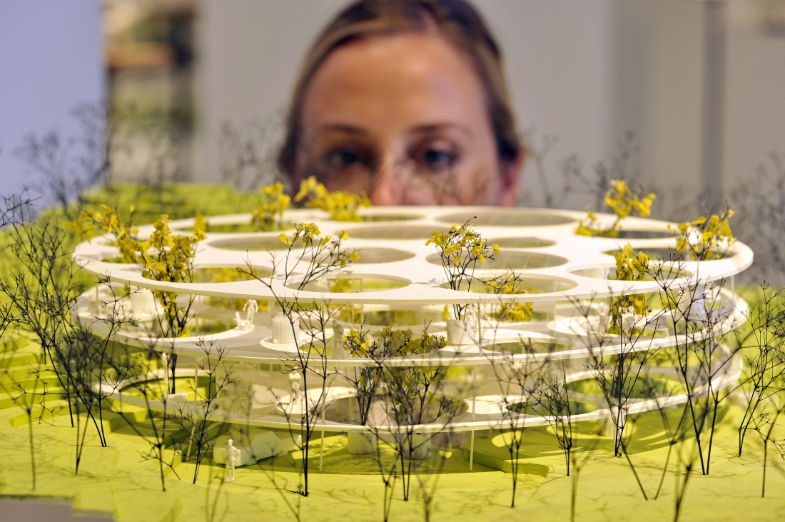 A member of staff at Japan House London inspects House in Catalonia, one of 100 exhibits on display in the inaugural exhibition, Futures of the Future by acclaimed Japanese architect Sou Fujimoto