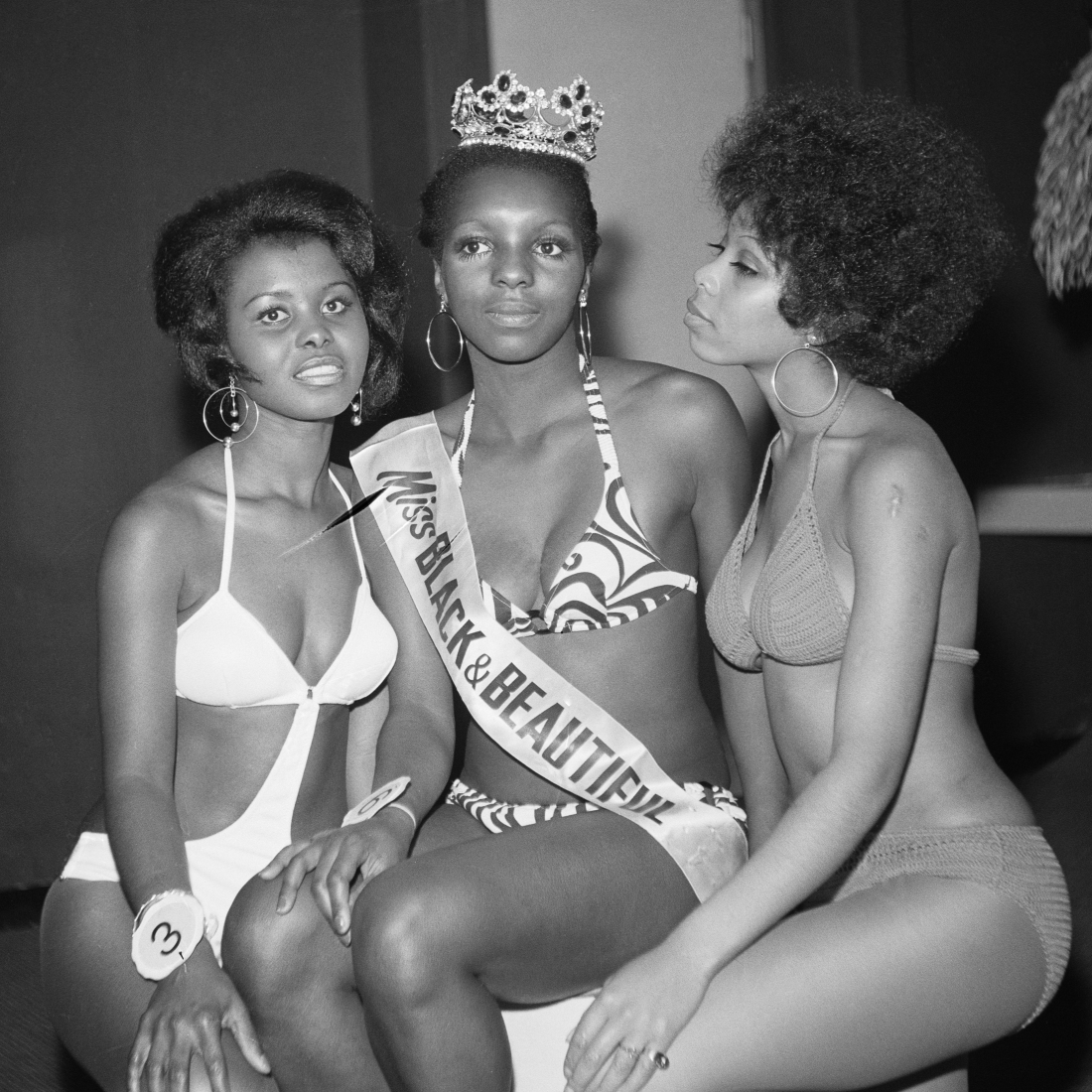 (unidentified) Miss Black & Beautiful with fellow contestant Angela Ramsey left and unidentified contestant, London, Hammersmith Palais, 1970s. From the portfolio 'Black Beauty Pageants'. © Raphael Albert, courtesy Autograph ABP
