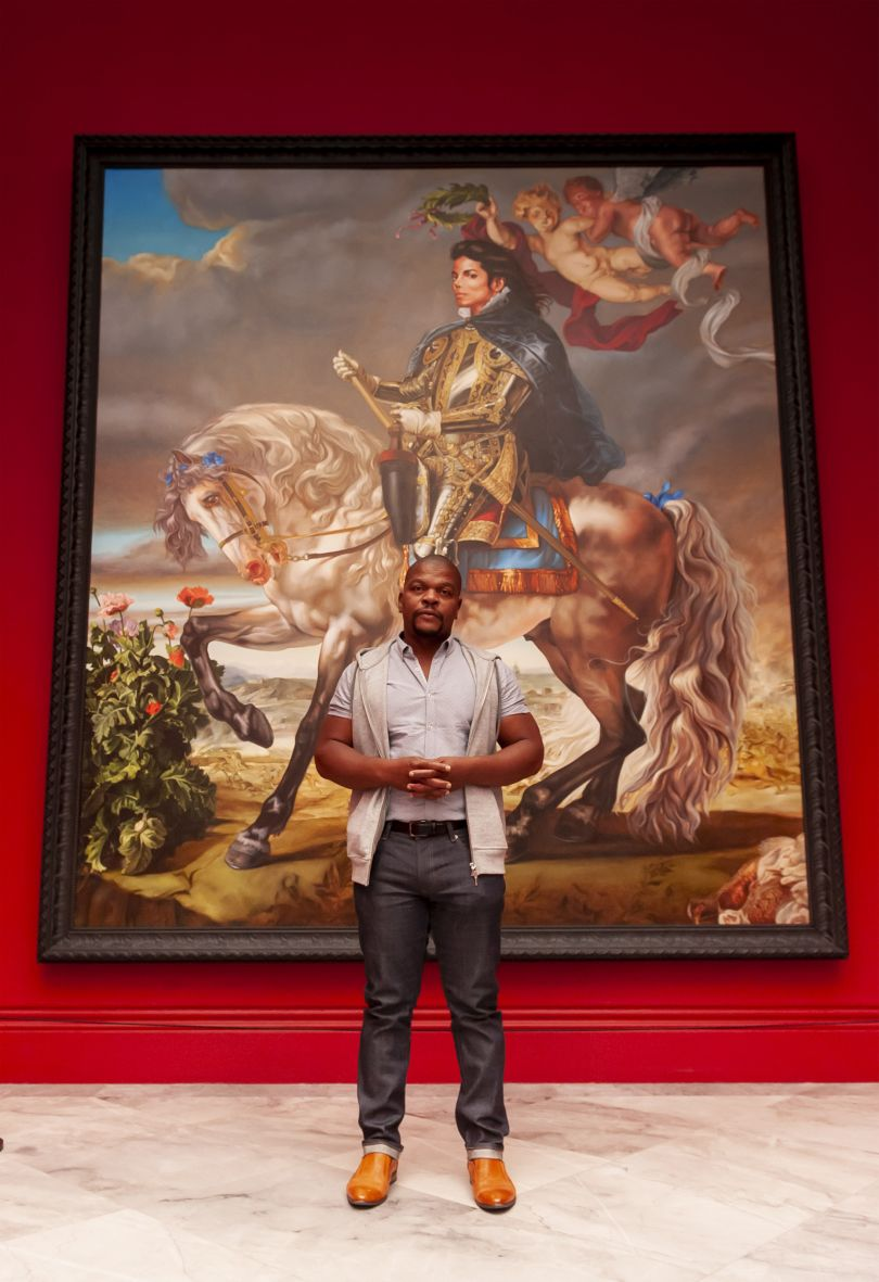 Kehinde Wiley in front of his painting, Equestrian Portrait of King Philip II, 2009. Photograph by Jorge Herrera