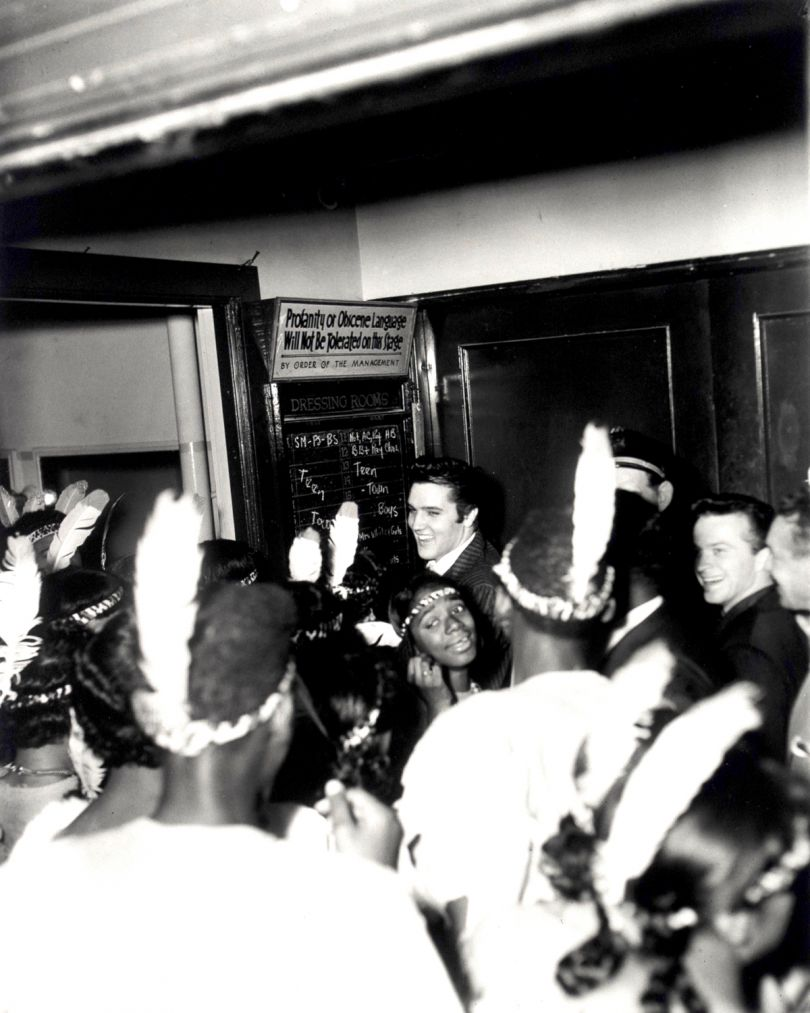Elvis backstage, WDIA Goodwill Revue, Ellis Auditorium, December 7, 1956 (CarlaThomas in front) © Estate of Ernest C Withers. Courtesy of Michael Hoppen Gallery