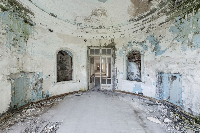 Past grandeur: the view inside an ornate room where patients with respiratory problems were treated. Many of the ex-Soviet sanatoria all featured light blue paints, benefiting to a very refined and typical style. Gagra, Abkhazia. © Reginald Van de Velde