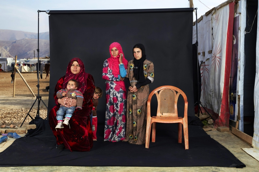 People, third prize singles: Portrait of a Syrian refugee family in a camp in Bekaa Valley, Lebanon. The empty chair in the photograph represents a family member who has either died in the war or whose whereabouts are unknown. Dario Mitidieri.
