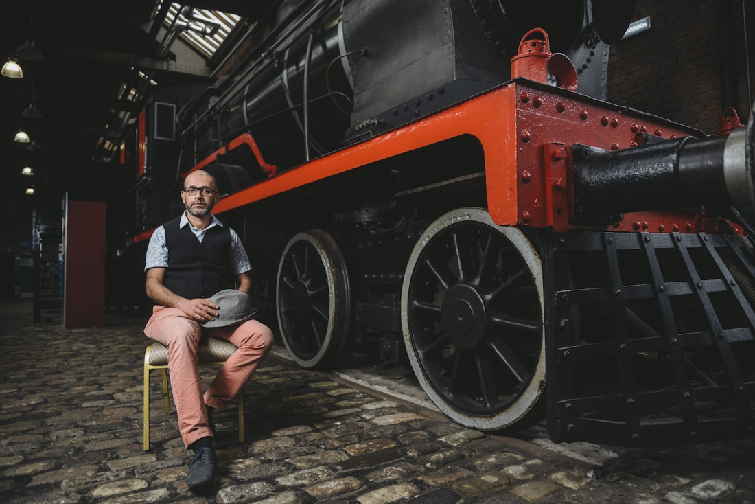 Artist Nikhil Chopra in front of Steam Locomotive 3157 at the Museum of Science and Industry, Manchester, 2017. Image courtesy of Museum of Science and Industry.