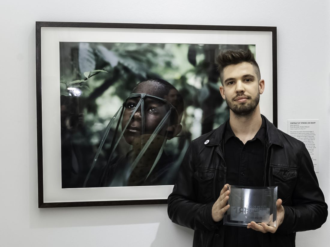 Joint third prize winner Joey Lawrence with his portrait. Photograph by Jorge Herrera