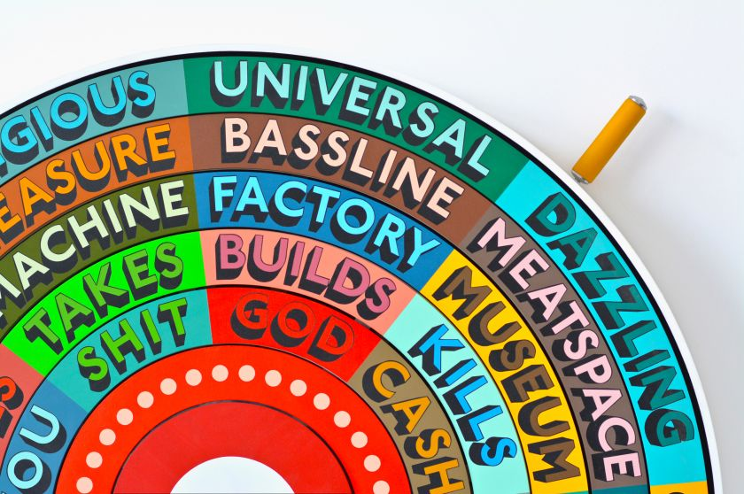 A rainbow-coloured wheel of fortune by artist Tim Fishlock that helps us to make random, dystopian poems