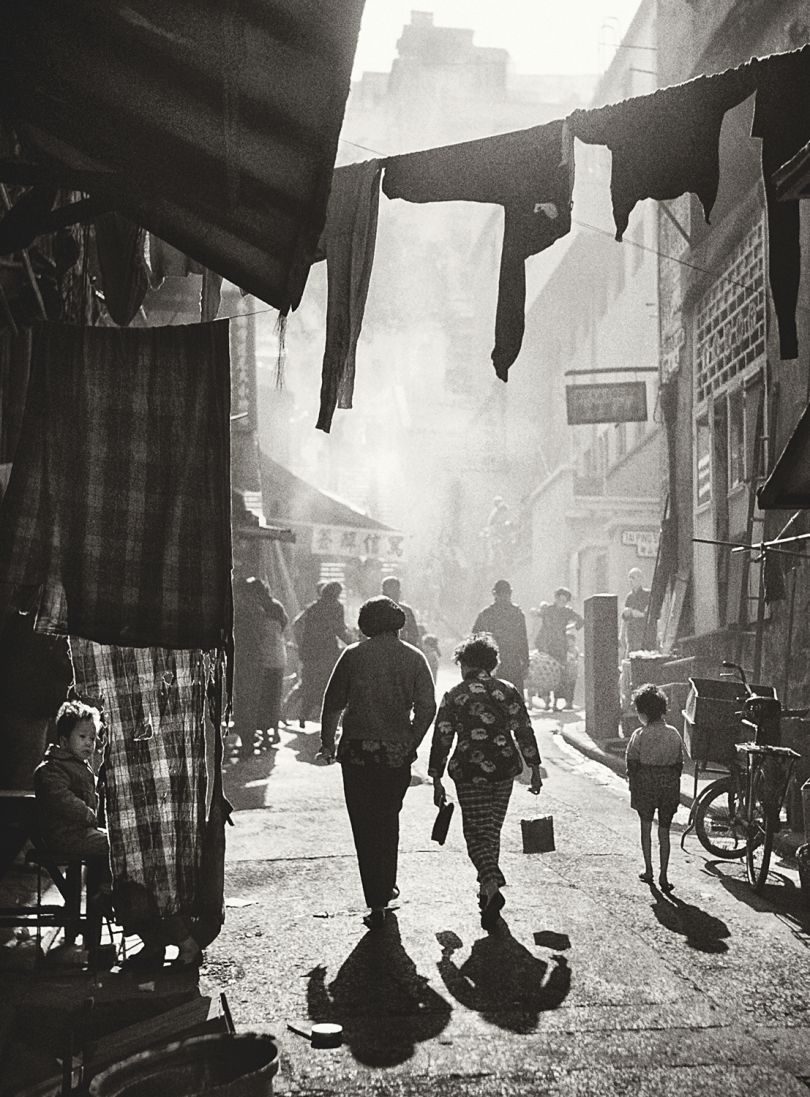 Fan Ho 'Strolling to Tai Ping Shan Street(漫步太平山街)' Hong Kong 1950s and 60s, courtesy of Blue Lotus Gallery