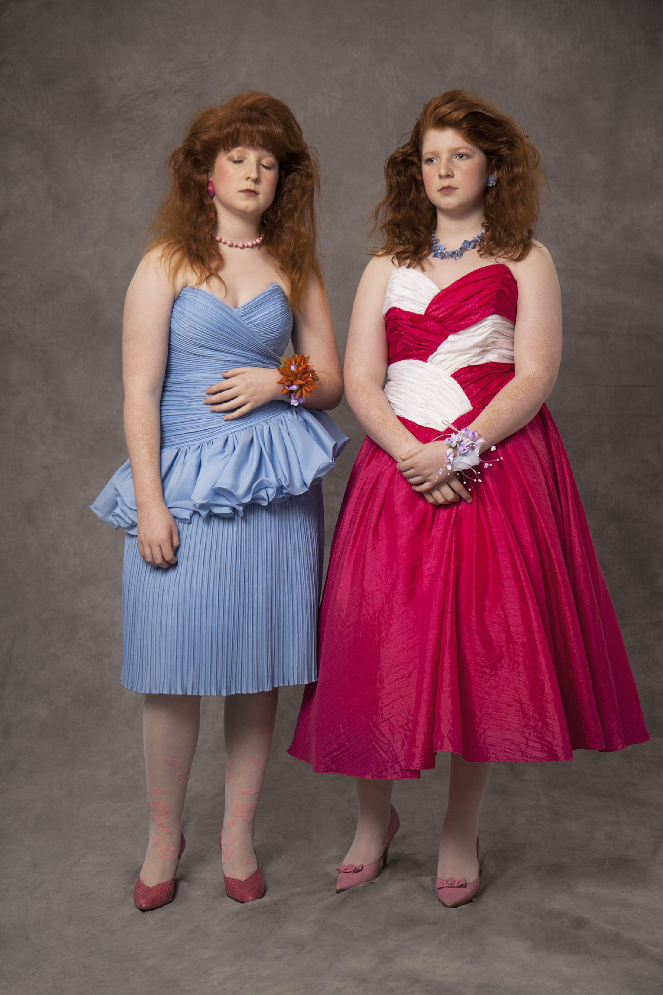 Two young girls at an 80s prom.