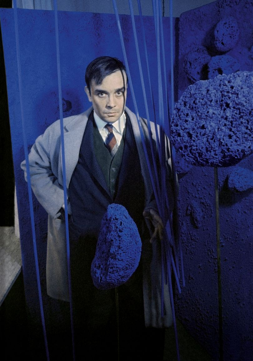 Yves Klein surrounded by his « Sponge Sculptures » during the opening of the exhibition
