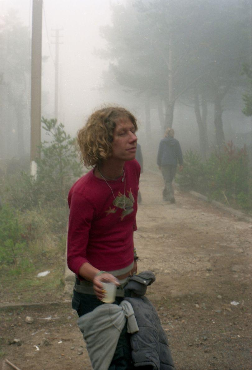 Sacha dancing in the mist, Teknival near Barcelona 2003 © Seana Gavin