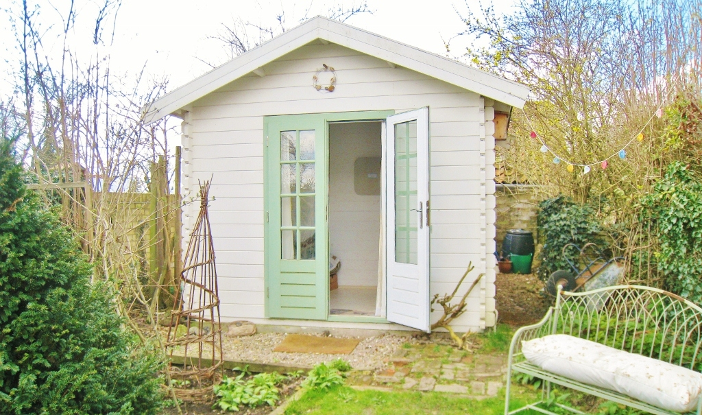 Silverpebble 39 s office in cambridge is set in a beach hut for Beach hut style