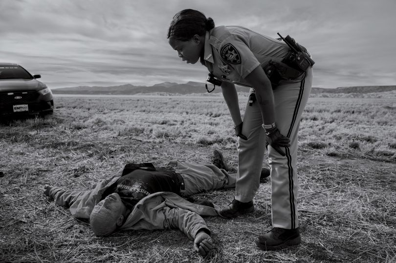 Dorothy Onikute, 33, a deputy sheriff with the Rio Arriba County sheriff's office, responding to an overdose call on Feb. 4, on the side of the road in Alcalde, N.M. Photograph by James Nachtwey for TIME