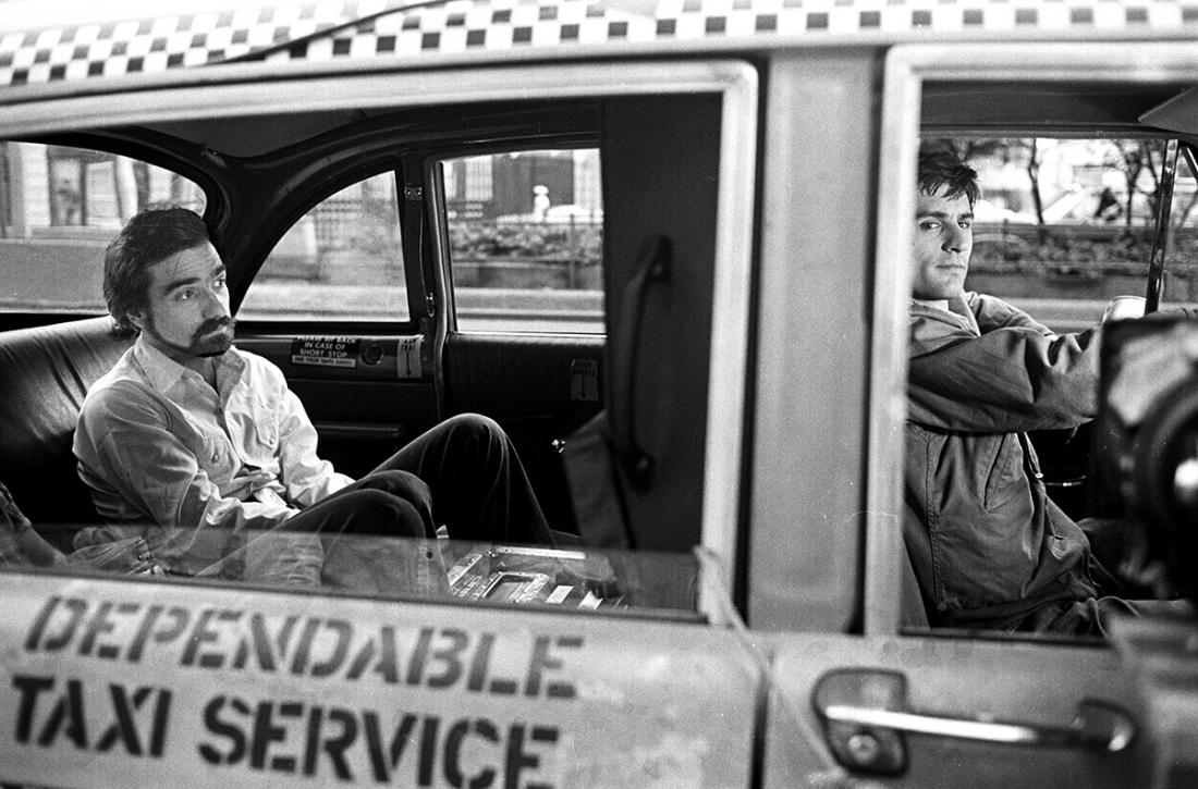 Martin Scorsese in the back of De Niro's cab during filming of Taxi Driver, New York, 1975. © Steve Schapiro, courtesy Howard Greenberg Gallery, New York