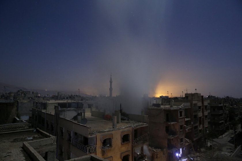 Spot News, first prize stories: Smoke rises from a building following reported shelling by Syrian government forces in Douma, Syria. Sameer Al-Doumy.