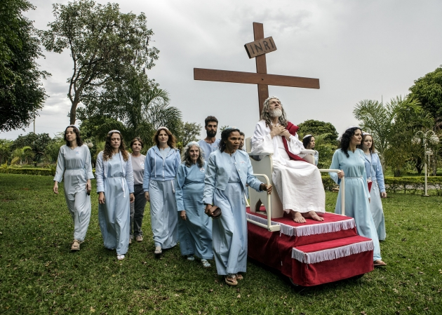 INRI Cristo is wheeled around their compound on a rolling pedestal. INRI are the initials that Pontius Pilate had written on top of Jesus' cross, meaning Jesus Christ, King of the Jews. Brazil, 2014 | © Jonas Bendiksen/ Magnum Photos