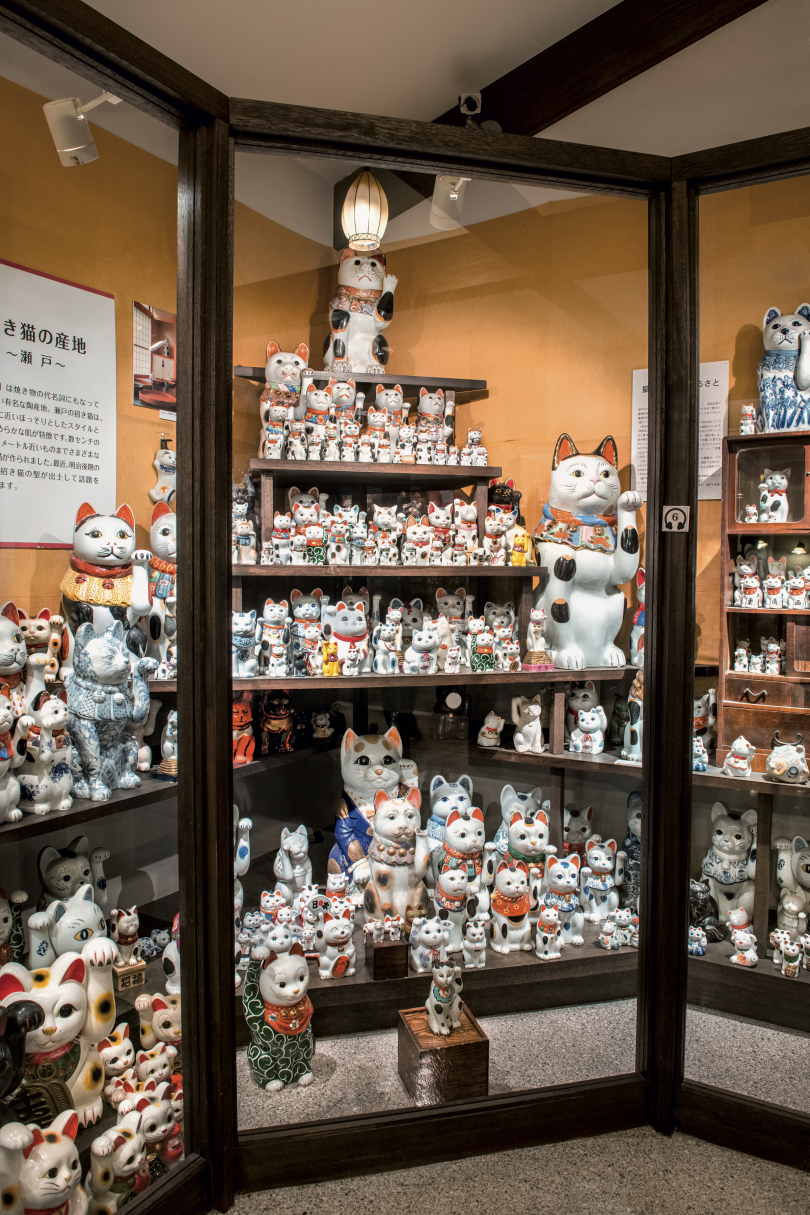 A display of regional Seto cats at the Manekineko Museum. They are slim, look closer to real cats and wear bibs with pleats and bells. © Julian Krakowiak