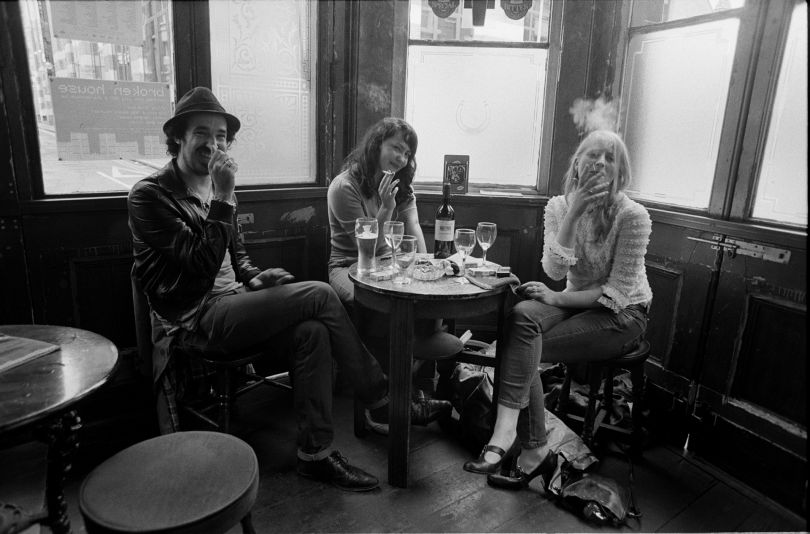 Friends enjoy a final smoke indoors on the final day of legal smoking in public places. The Griffin, Shoreditch - 2007