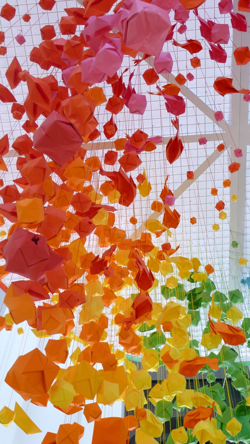 Giant, rainbow hanging installation of 1,000 origami ...