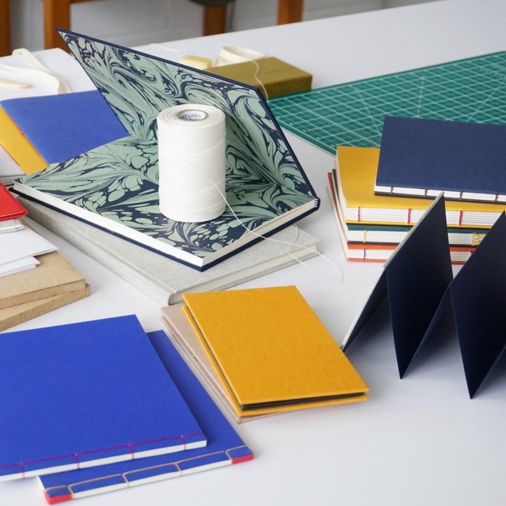Book binding with LCBA